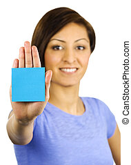 Young woman has a sticky note stuck on her hand - A pretty,...