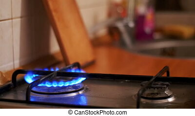 Ignition Of The Gas In The Burner On The Home Kitchen Stove....