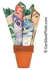 Canadian Cash rolled up in jar - Rolled up Canadian cash in...
