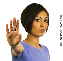 STOP! Young woman holds hand up. - STOP! An ethnic woman...