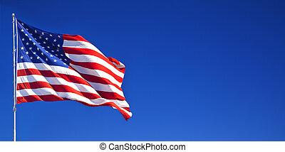 American flag waving in blue sky 1 - American flag waving in...