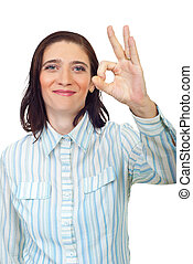 Smiling mid adult woman showing okay sign