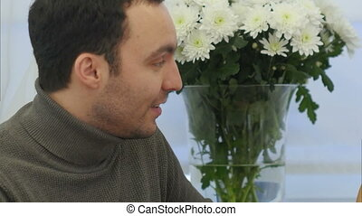 Face of businessman talking to female colleague in office