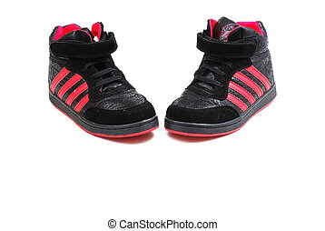 Footwear for playing sports of black colour with red strips...