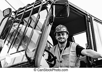 Operating on Skid Steer Loader - Construction worker...
