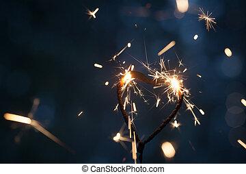 Heart shape sparkler burning in the dark