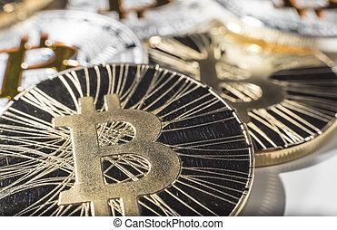 BTC Bitcoin coins - Shining metal BTC bitcoin coins on white...