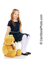 Girl with a Teddy bear. - Beautiful little girl in a blue...