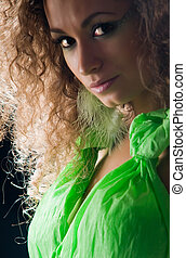 Beautiful young woman with curly hair - Portrait of young...