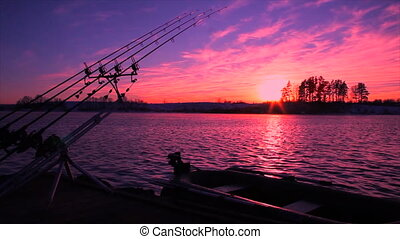 Timelapse of fishing at sunset. Fishing rods and fishing...