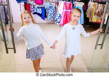 two girls shopping - Two cute little girls go shopping....