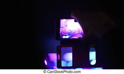 Concert Crowd at Music Festival and Filming on Smartphones -...