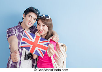 couple take british flag - young couple take british flag...