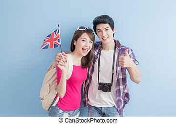 couple take british flag - young couple take british flag...