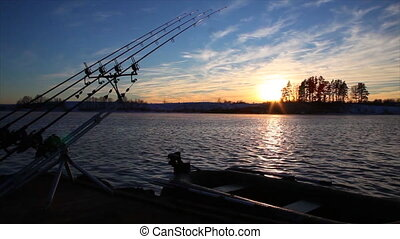 Timelapse of fishing rods taking fish and boat on the water...
