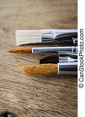 Clean Paintbrushes on Oak Wood Table