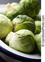 Brussel Sprouts in White Enamel Baking Tin - Close up of...