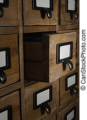 Card Index Drawer Opened in Dark Room - Angled side view of...