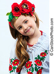 Young pretty girl in a ukrainian national costume on a light...