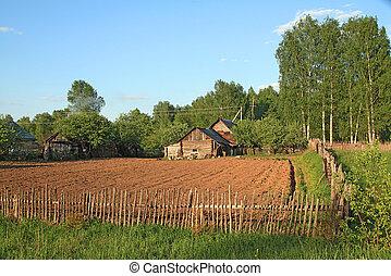 rural house near plow field