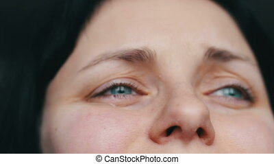 Close up portrait of upset woman with tears closes face with hands