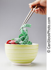 diet - stock image of the chopstick and measuring tape