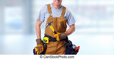 Construction worker with hammer - Professional construction...