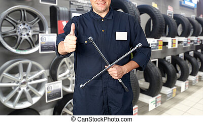 Car mechanic. - car mechanic with tire wrench in auto repair...