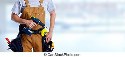 Construction worker with drill - Professional construction...