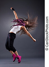 modern style dancer posing on studio background - energy...
