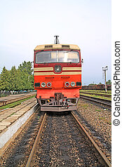 old diesel locomotive on railway station