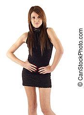 brunette posing in black dress