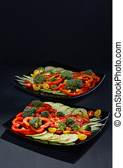 Beautifully and appetizingly cut fresh vegetables and...
