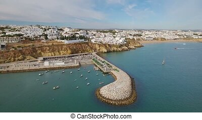 Aerial. Tourist boats on the move in the marina Albufeira....