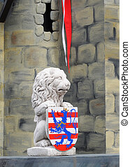 Stone lion holding escutcheon of bruges, belgium, europe