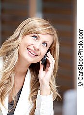 Positive businesswoman talking on phone