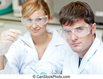 Two caucasian scientists doing experiments