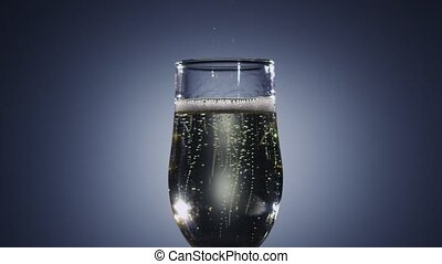 Slow motion. Bubbles of champagne wine disappear from the drink