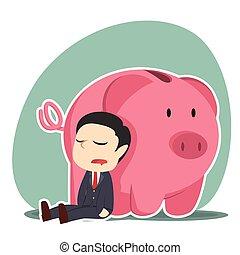 businessman sleeping beside piggy bank