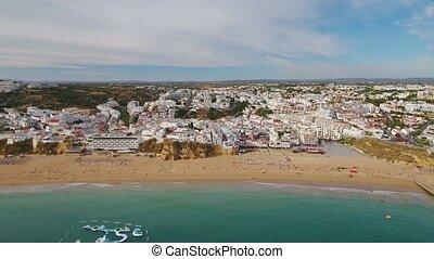 Aerial. Beach fishermen from the sky of Albufeira. Algarve...