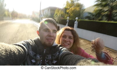 Couple showing keys of their new house