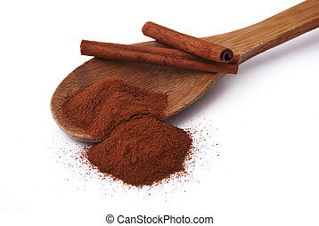 cinnamon - wooden spoon with cinnamon and a few tubes of...