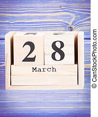 March 28th. Date of 28 March on wooden cube calendar