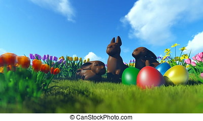 Easter Eggs and Chocolate Bunnies on green meadow with colorful tulips