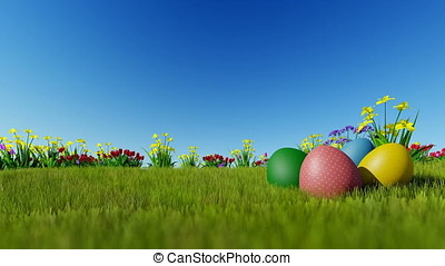 Easter eggs ongreen meadow over blue sky