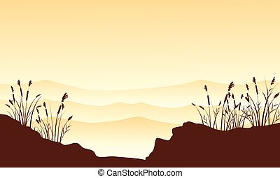 Silhouette of desert with course grass landscape