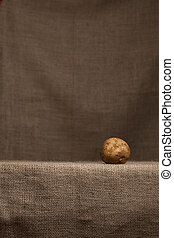 Potato Resting on Hessian (burlap) - Poato resting on...