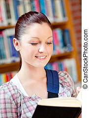 Positive young caucasian woman reading a book