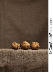 Potatoes Resting on farmer's Hessian (burlap) - Poatoes...