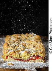 Homemade crumble cherry cake and powder sugar